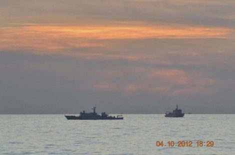 A handout photo shows two Chinese surveillance ships which sailed between a Philippines warship and eight Chinese fishing boats to prevent t