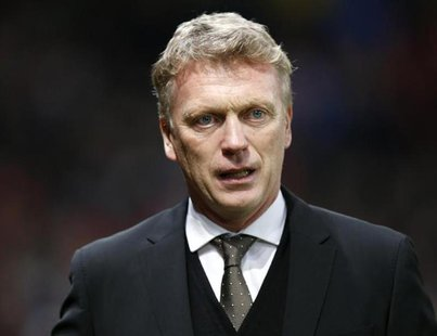 Manchester United manager David Moyes attends their English FA Cup soccer match against Swansea City at Old Trafford in Manchester, northern