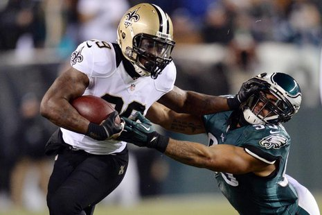 New Orleans Saints running back Khiry Robinson (29) stiff arms Philadelphia Eagles inside linebacker Mychal Kendricks (95) during the first