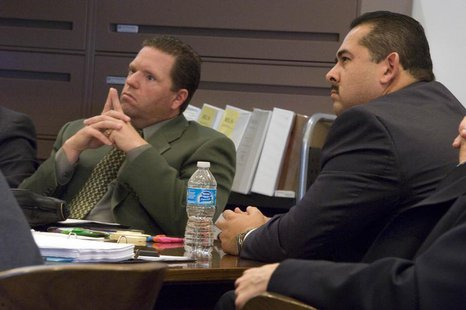 Former Fullerton police officers Jay Cicinelli (L), and Manuel Ramos (R) listen during the trial of Ramos and Cincinelli in Santa Ana, Calif