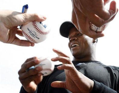 Toronto Blue Jays' Frank Thomas signs autographs before his team's spring training baseball game against the Boston Red Sox in Dunedin, Flor