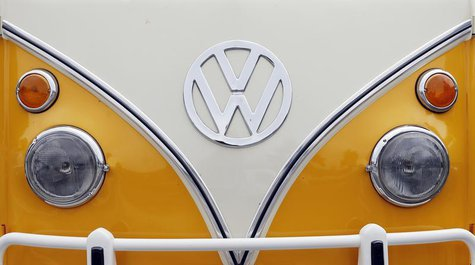 The Volkswagen logo is seen on a Kombi minibus during a Kombi fan club meeting in Sao Bernardo do Campo December 8, 2013. REUTERS/Paulo Whit