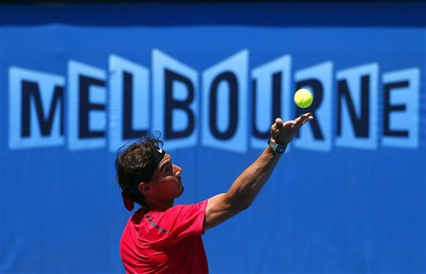 Spain's Rafael Nadal serves during a training session at Melbourne Park January 9, 2014. REUTERS/David Gray