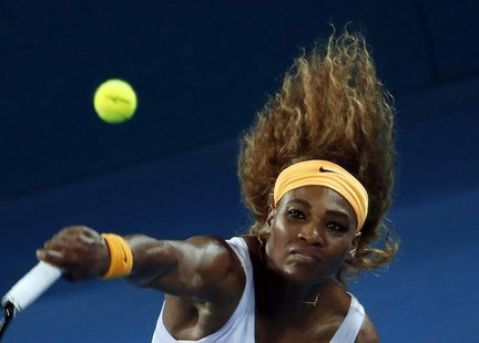 Serena Williams of the U.S. serves to Victoria Azarenka of Belarus during their women's final match at the Brisbane International tennis tou