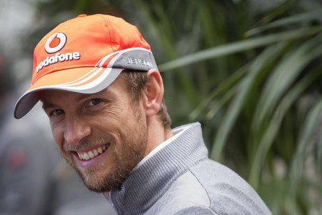 McLaren Formula One driver Jenson Button of Britain smiles while giving an interview at the Circuit of The Americas in Austin, Texas Novembe
