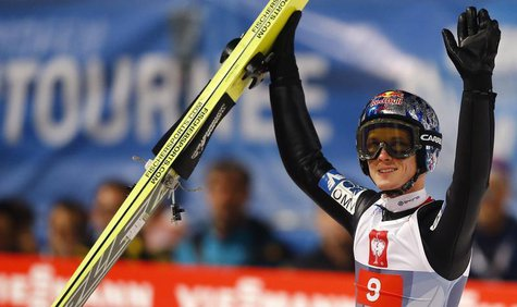 Austria's Thomas Morgenstern reacts after taking the second place in the overall ranking of the four-hills ski jumping tournament after the