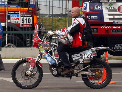 Belgium's Eric Palante rides his Honda for a technical verification exercise of the sixth South American edition of the Dakar Rally 2014, in
