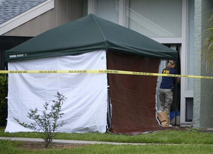 A member of the FBI enters the apartment of Ibragim Todashev, 27, in Orlando, Florida, May 22, 2013 file photo. REUTERS/Phelan M. Ebenhack