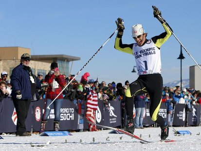 Todd Lodwick of the United States stamps on the finish line with his skis to come in first during the U.S. Olympic nordic combined trials at