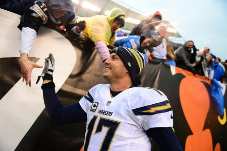 San Diego Chargers quarterback Philip Rivers (17) celebrates with fans after defeating the Cincinnati Bengals 27-10 to win AFC wild card pla