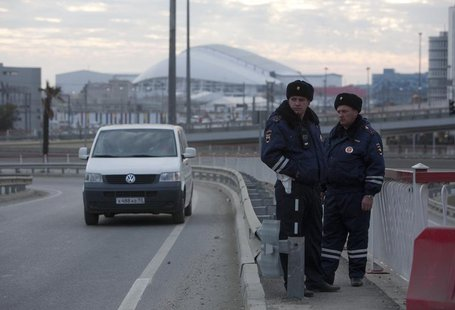 Russian traffic police officers stand guard during patrol on a road near venues at the Olympic Park near Sochi January 7, 2014. REUTERS/Kazb