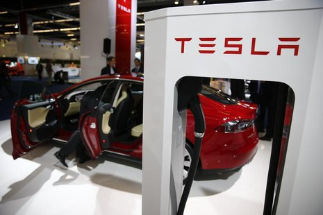 A Tesla model S car with an electric vehicle charging station is displayed during a media preview day at the Frankfurt Motor Show (IAA) Sept