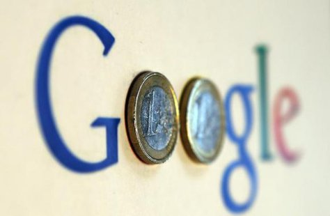 An illustration picture shows a Google logo with two one Euro coins, taken in Munich January 15, 2013. CREDIT: REUTERS/MICHAEL DALDER