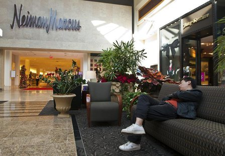 A man sleeps on a couch outside of a Neiman Marcus store at South Park mall in Charlotte, North Carolina November 25, 2011. REUTERS/Chris Ke
