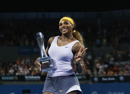 Serena Williams of the U.S. holds up the Brisbane International trophy after defeating Victoria Azarenka of Belarus in the women's singles f