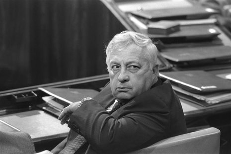 Israel's Minister of Industry and Trade Ariel Sharon sits in a session of Israel's parliament in Jerusalem May 6, 1985 in this file photo re