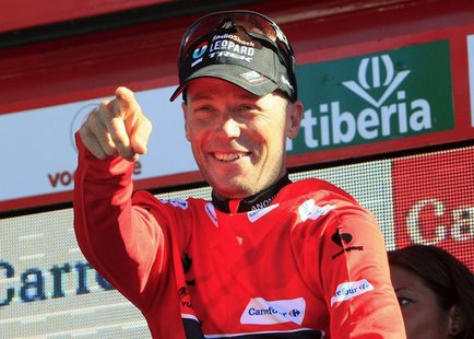 Chris Horner of the U.S. celebrates on the podium after retaking the overall race lead in the 181-km 19th stage of the Vuelta, Tour of Spain