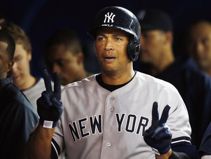 New York Yankees Alex Rodriguez celebrates his home run against the Toronto Blue Jays during the fifth inning of their MLB American League b