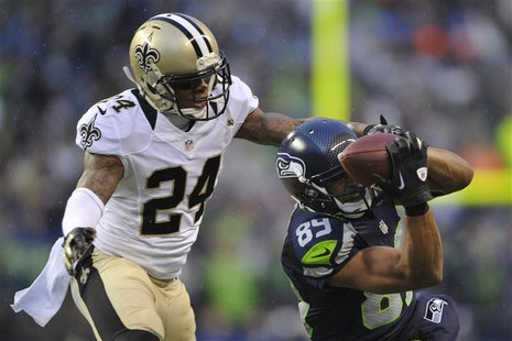 Jan 11, 2014; Seattle, WA, USA; Seattle Seahawks wide receiver Doug Baldwin (89) catches a pass against New Orleans Saints cornerback Corey