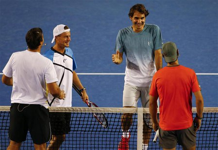 Roger Federer of Switzerland (2nd R) smiles as he goes to shake hands with Rafael Nadal of Spain (R) as Lleyton Hewitt of Australia (2nd L)