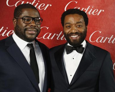 "British film director Steve McQueen (L) poses backstage with the star of his film Chiwetel Ejiofor from ""12 Years A Slave"" after winning Dir"