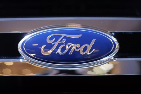 A Ford logo is seen on a car during a press preview at the 2013 New York International Auto Show in New York, March 28, 2013. REUTERS/Mike S