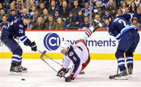 Jan 11, 2014; Winnipeg, Manitoba, CAN; Columbus Blue Jackets forward Nathan Horton (8) falls as he battles for the puck with Winnipeg Jets d