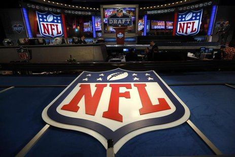 The NFL logo and set are seen at New York's Radio City Music Hall before the start of the 2013 NFL Draft April 25, 2013 file photo. REUTERS/