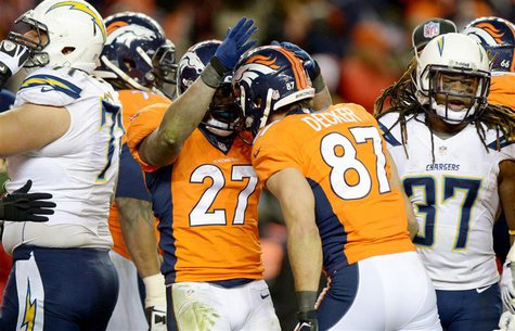 Jan 12, 2014; Denver, CO, USA; Denver Broncos running back Knowshon Moreno (27) celebrates with receiver Eric Decker (87) after scoring a to