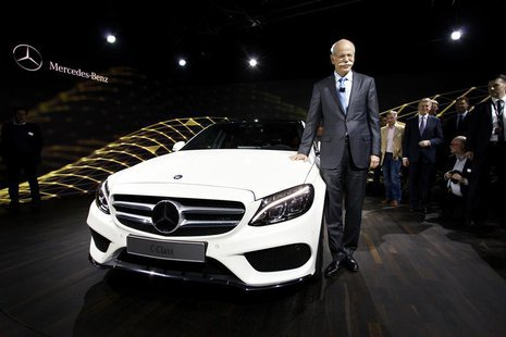 Chairman of Daimler AG and Head of Mercedes-Benz Cars Dieter Zetsche stands next to the new Mercedes-Benz 2015 C-Class during a private prev