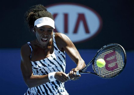 Venus Williams of the U.S. hits a return to Ekaterina Makarova of Russia during their women's singles match at the Australian Open 2014 tenn