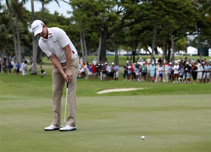 Jimmy Walker of the U.S. putts on the 18th green during the third round of the Sony Open golf tournament at Waialae Country Club in Honolulu