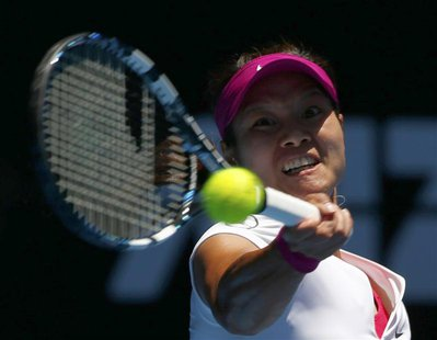 Li Na of China serves to Ana Konjuh of Croatia during their women's singles match at the Australian Open 2014 tennis tournament in Melbourne
