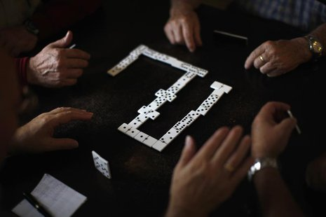 Pensioners play dominoes at a seniors centre during the International Day of Older Persons in Ronda, near Malaga October 1, 2013. REUTERS/Jo