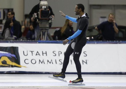 Dec 31, 2013; Kearns, UT, USA; First place finisher Shani Davis after he competes in the men's 1500m during the U.S. Olympic speedskating tr