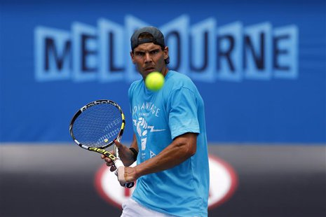 Rafael Nadal of Spain hits a return during a practice session at the Australian Open 2014 tennis tournament in Melbourne January 12, 2014. R