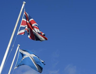 The Saltire (R) and Union Flag fly together in a street before a debate in the Scottish Parliament on 'Scotland's future,' in Edinburgh, Sco
