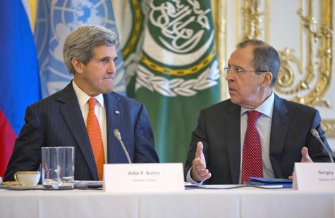 U.S. Secretary of State John Kerry (L) listens to Russia's Foreign Minister Sergei Lavrov before the start of their joint meeting with U.N/A