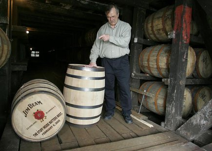 Master distiller Jerry Dalton points at the 10,000,000 millionth barrel of bourbon whiskey at the Jim Beam distillery in Clermont, Kentucky