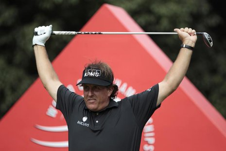 Phil Mickelson of the U.S. exercises before tees off on the 16th hole during the first round of the WGC-HSBC Champions golf tournament in Sh