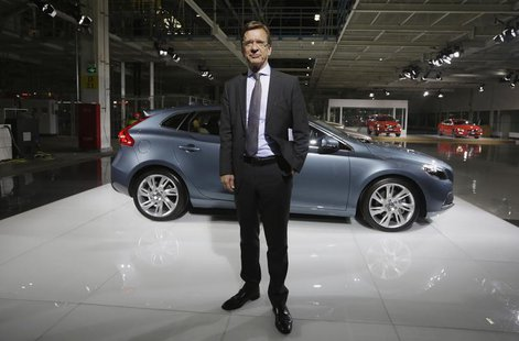 CEO of Volvo Cars Hakan Samuelsson poses for a photo next to a Volvo V40 TS car at the new Volvo automobile manufacturing plant in Chengdu,