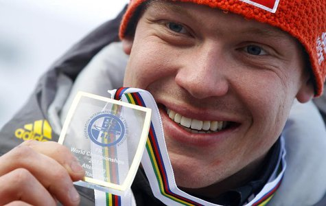 Germany's Felix Loch presents his gold medal after winning the FIL Luge World Championships in Altenberg February 11, 2012. REUTERS/Dominic