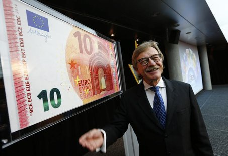 Yves Mersch, Member of the Executive Board of the European Central Bank presents an oversized newly unveiled 10 euro note at the headquarter