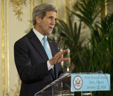 U.S. Secretary of State John Kerry speaks during a joint news conference with Qatar Foreign Minister Khaled Al-Attiyah at the U.S. Ambassado