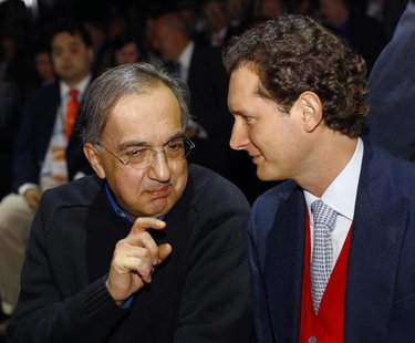 Chrysler-Fiat CEO Sergio Marchionne (L) chats with Fiat Group Chairman John Elkann during the press preview day of the North American Intern