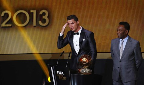 Portugal's Cristiano Ronaldo (L) gestures beside Pele after being awarded the FIFA Ballon d'Or 2013 in Zurich January 13, 2014. Portugal and