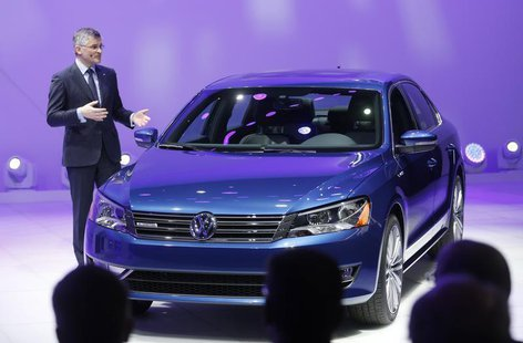 Incoming President and CEO of Volkswagen of America Michael Horn speaks next to the Passat BlueMotion during the press preview day of the No