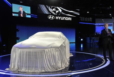 John Krafcik, President and Chief Executive Officer for Hyundai Motor America, gets ready to unveil the HCD14 luxury concept at the North Am