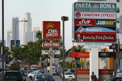 Signs of fast food restaurants are seen along a busy street in Los Angeles, California, May 11, 2012. REUTERS/David McNew