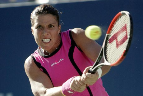 Jennifer Capriati of the United States hits a return to Elena Dementieva of Russia during their semifinal match at the 2004 U.S. Open in New